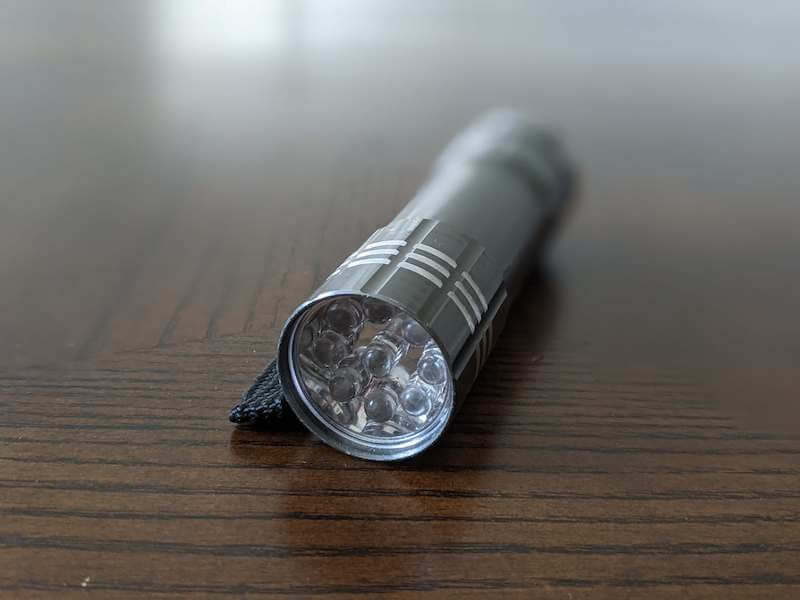 A flashlight on a table