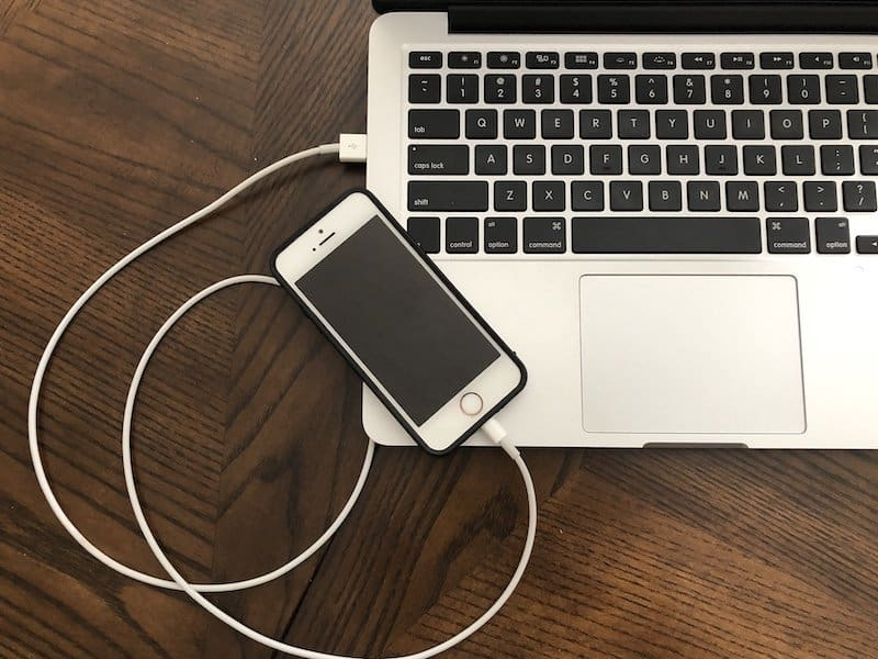 iPhone SE connected to Mac via lightning cable